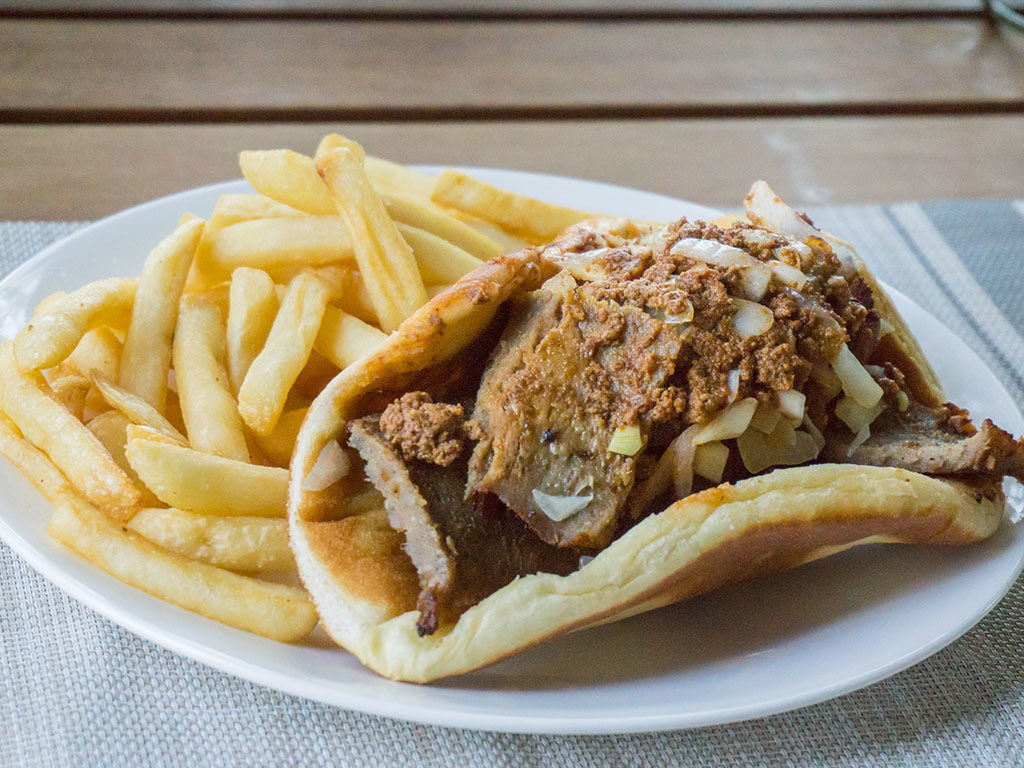 A restaurant bought Gyro with meat sauce and French fries