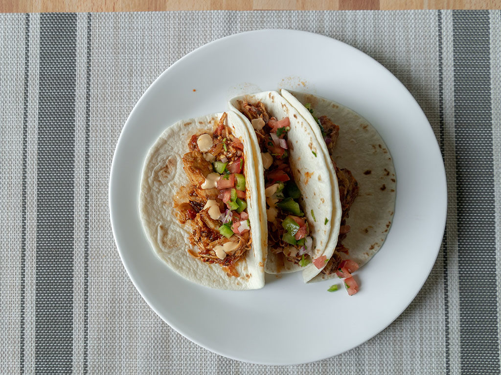 Chicken tinga tacos plated