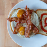 Air fried bacon and eggs on bread