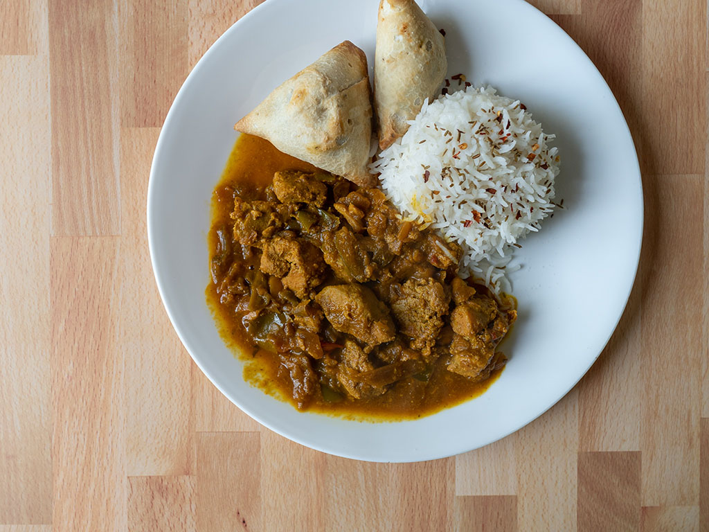 Bombay Kitchen Kadai Chicken with rice and samosa