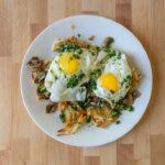 Fried eggs over matchstick potatoes