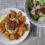 Hummus with pita chips and salad