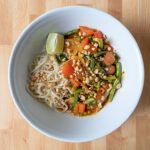 Rice noodles with Thai red curry fry