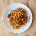 Spicy chicken sausage with linguine and pesto