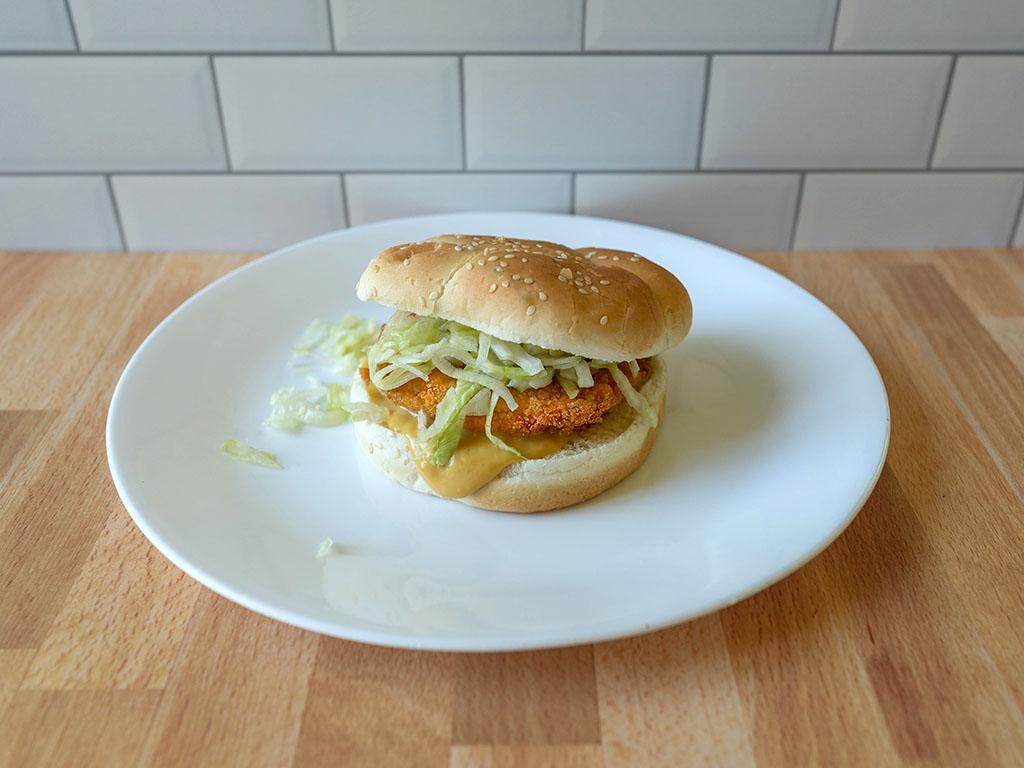 Tyson Frozen Chicken Patties on bun with lettuce and chicken sauce