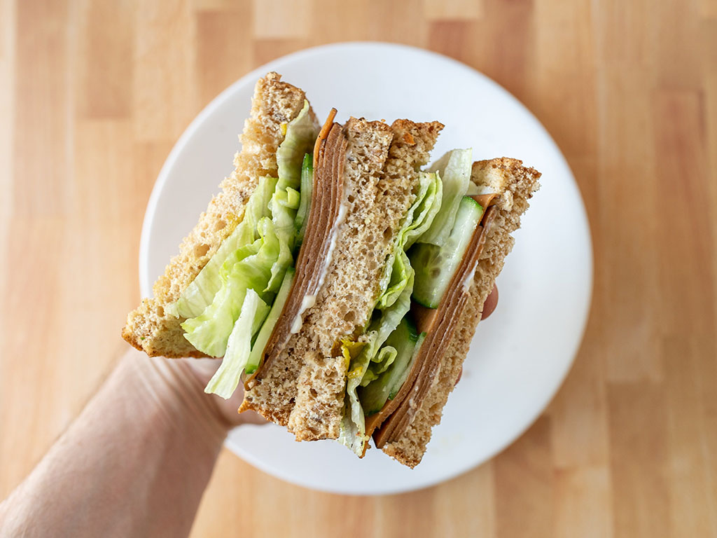 Simple Truth Plant Based Ham Style Deli Slices sandwich close up