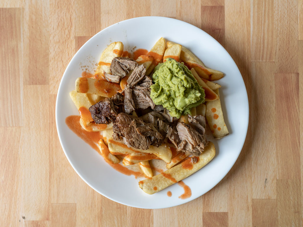 Ore-Ida Golden Steak Fries with  Kroger carnitas and guac