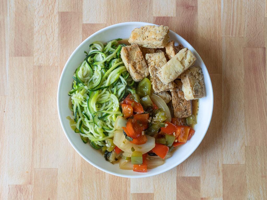 Crispy tofu in Thai chilli garlic sauce with zucchini noodles
