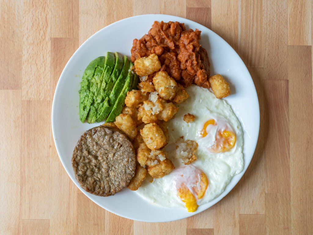 Simple Truth Meatless Breakfast Patties with eggs, avocado beans and tater tots