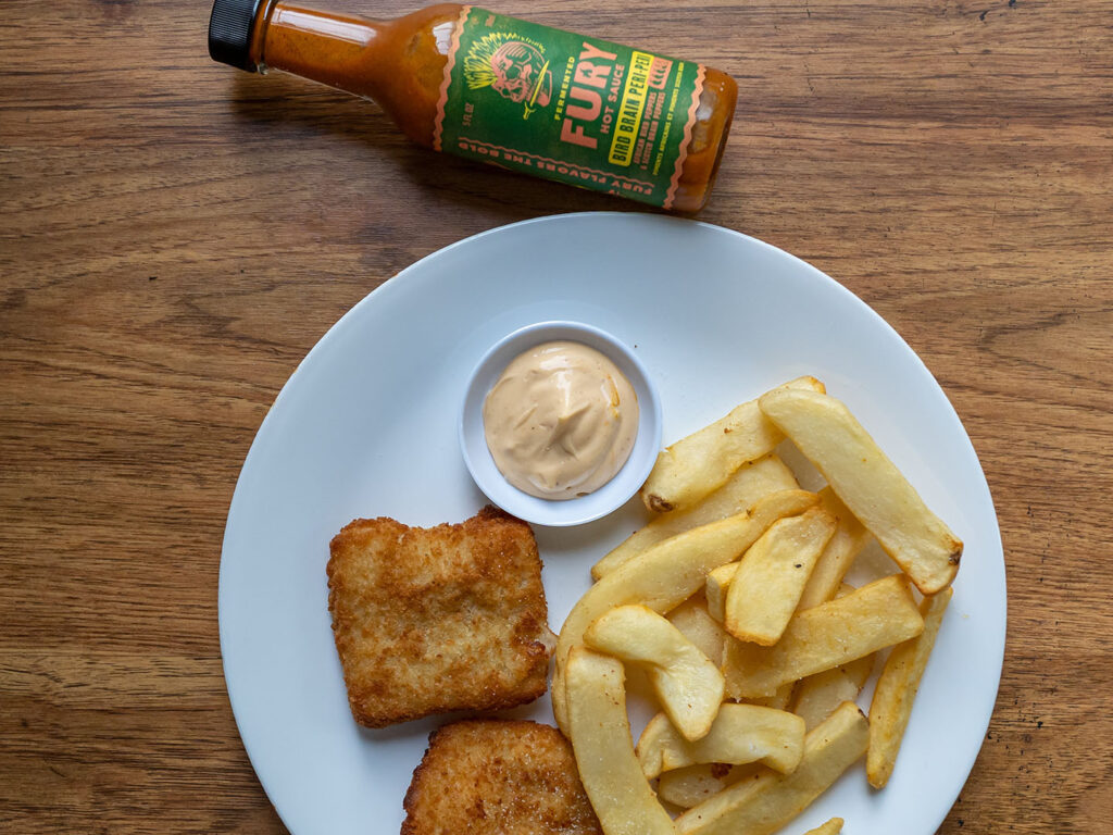 Fish and chips with Bird Brain Fury Hot Sauce peri PEri