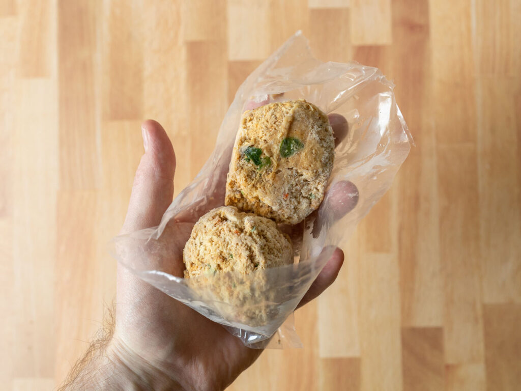 Whole Catch Maryland Style Crab Cakes frozen in hand