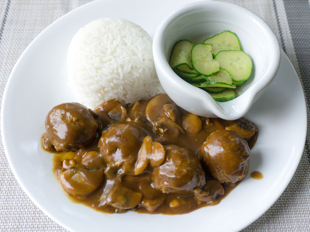 Gardein meatballs in Japanese curry with rice and sunomono above