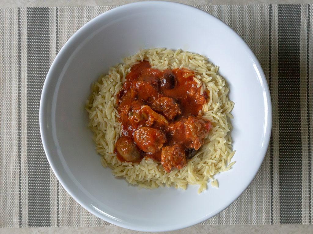 Johnsonville sausage in Newmans tomato sauce with orzo pasta