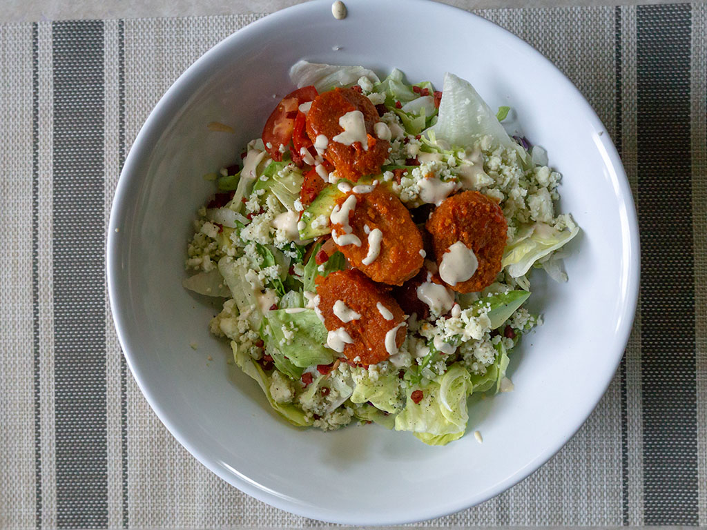 Buffalo salad with MorningStar Farms Chick'N Nuggets