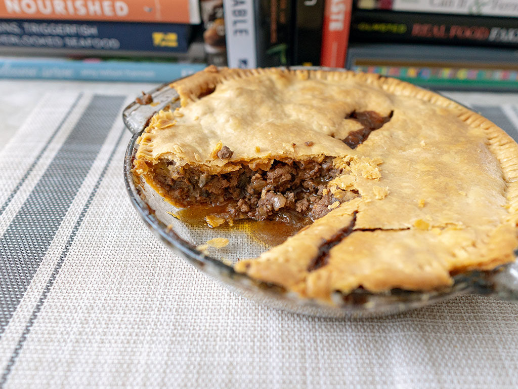 British beef and onion pie - pie 5 minutes from oven, note filling isnt spilling