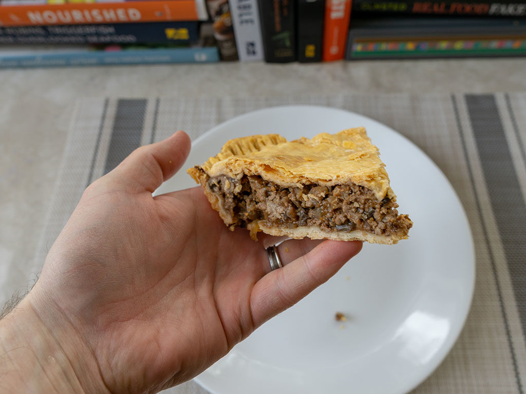 British beef and onion pie - refriegerated pie holding solid close up