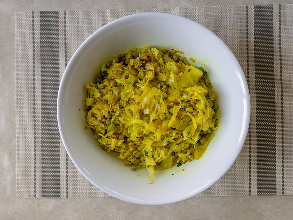 Indian cabbage and peas cooked and plated