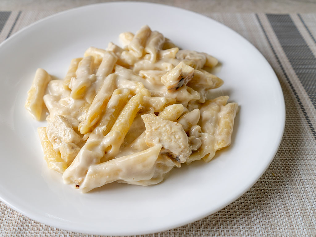 Three Bridges Chicken Penne Alfredo cooked side view