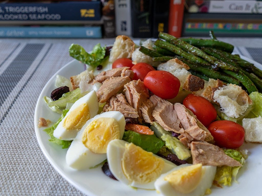 Tonnino Tuna Fillets In Olive Oil nicoise salad side view